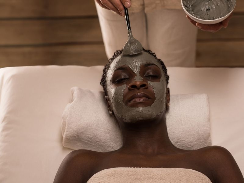 a woman with a face mask relaxing at a spa